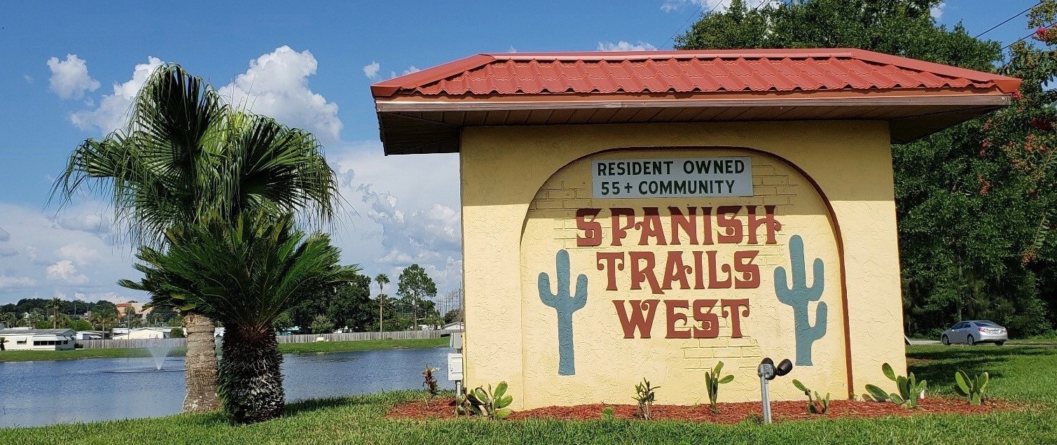Entrance sign for Spanish Trails West