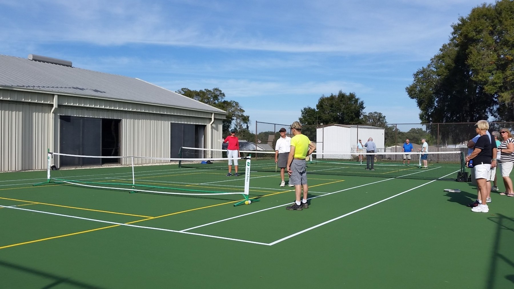 Tennis court with players present